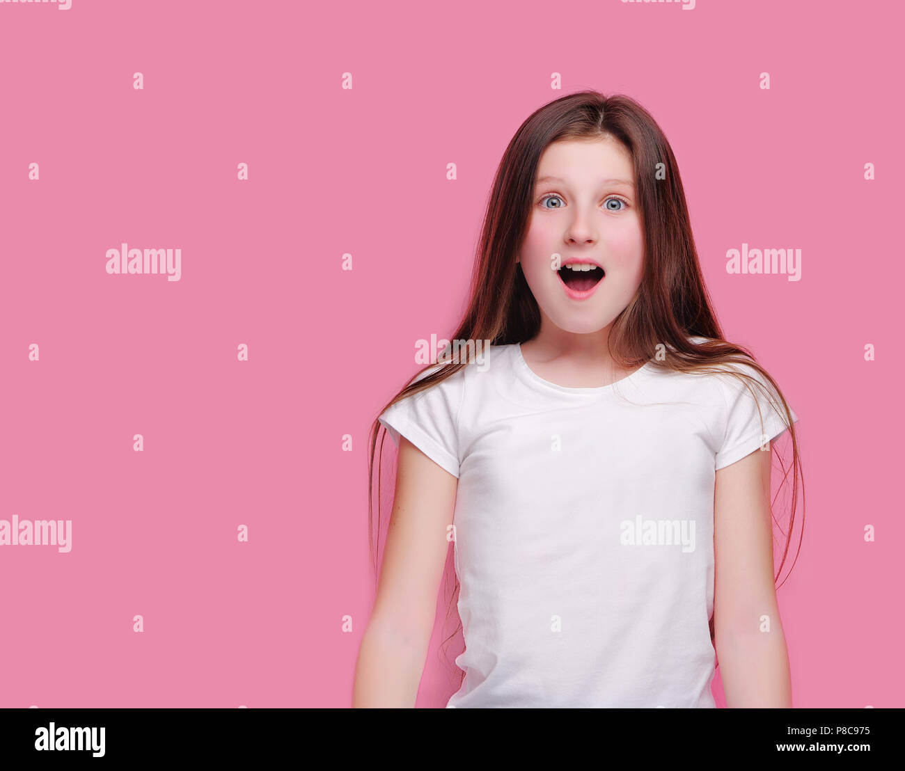 a80e81b0fc1d Closeup portrait of a surprised teen girl in a pink studio - Stock Image
