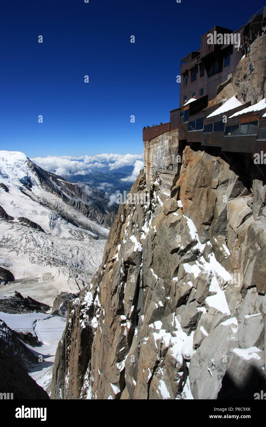 Even during summer ice and snow is omnipresent on the Mont Blanc. Seen from the observation platform on top of the Aiguille-du-Midi in France - Stock Image