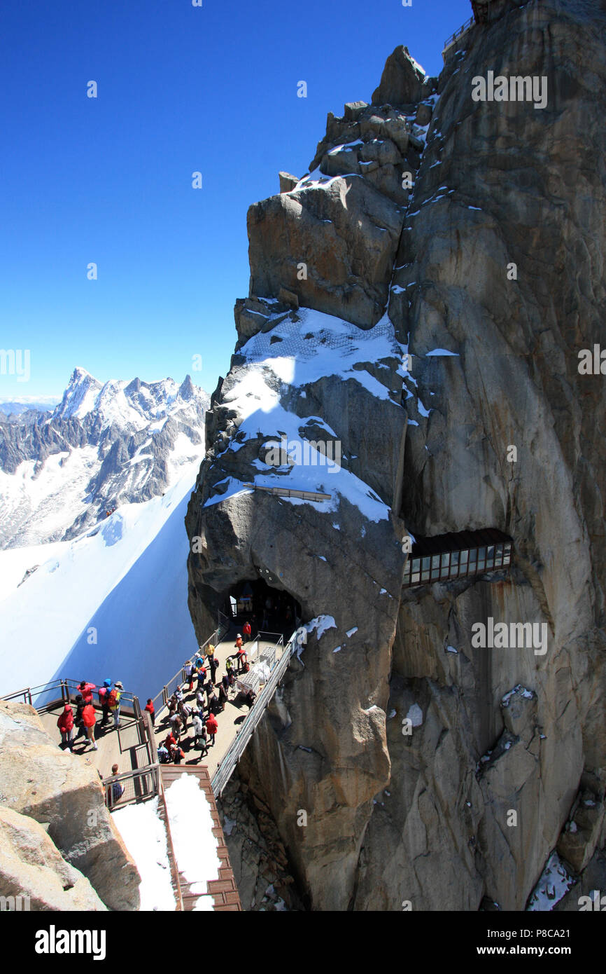 Tourists at the observation platform on top of Aiguille-du-Midi in the Mont Blanc massif in France - Stock Image