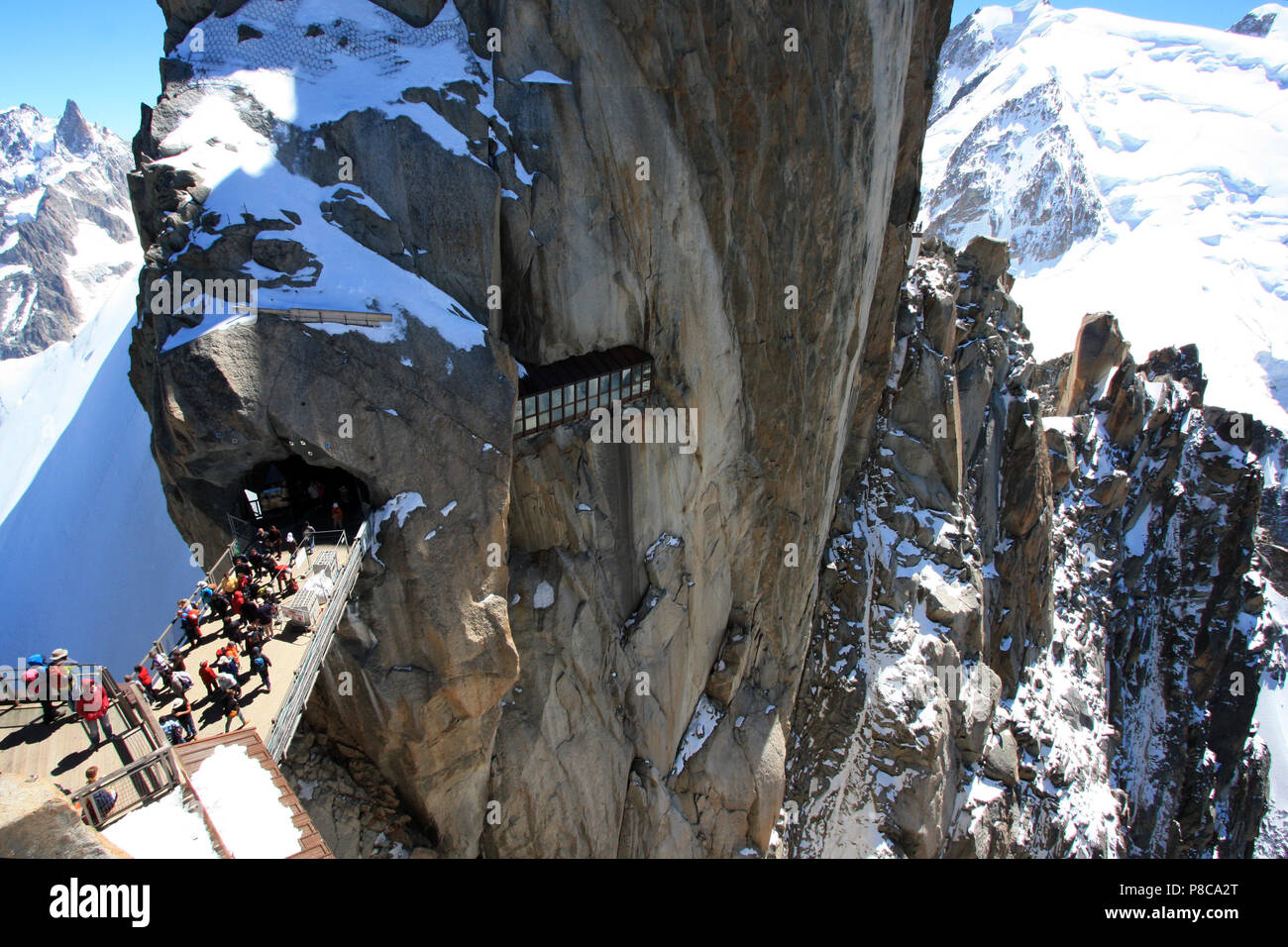 Tourists at the observation platform on top of Aiguille-du-Midi in the Mont Blanc massif in France Stock Photo
