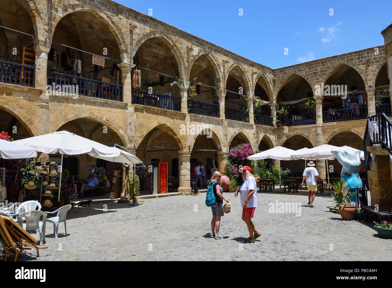 The courtyard of Buyuk Han, a former caravanserai, in North Nicosia (Lefkosa), Turkish Republic of Northern Cyprus - Stock Image