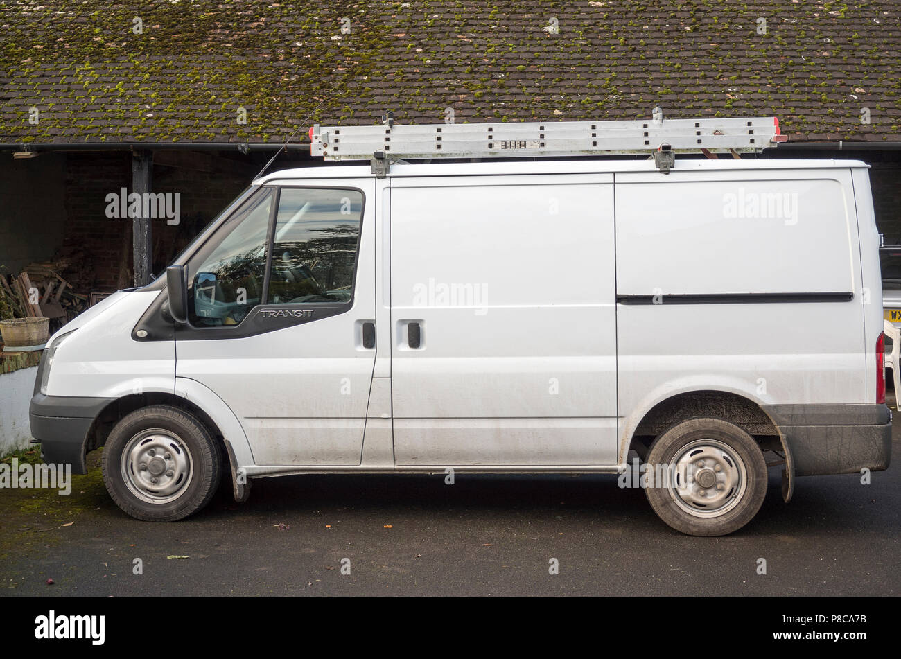 9f19976979 Side view of white Ford Transit 100 T260 utility business van in UK ...