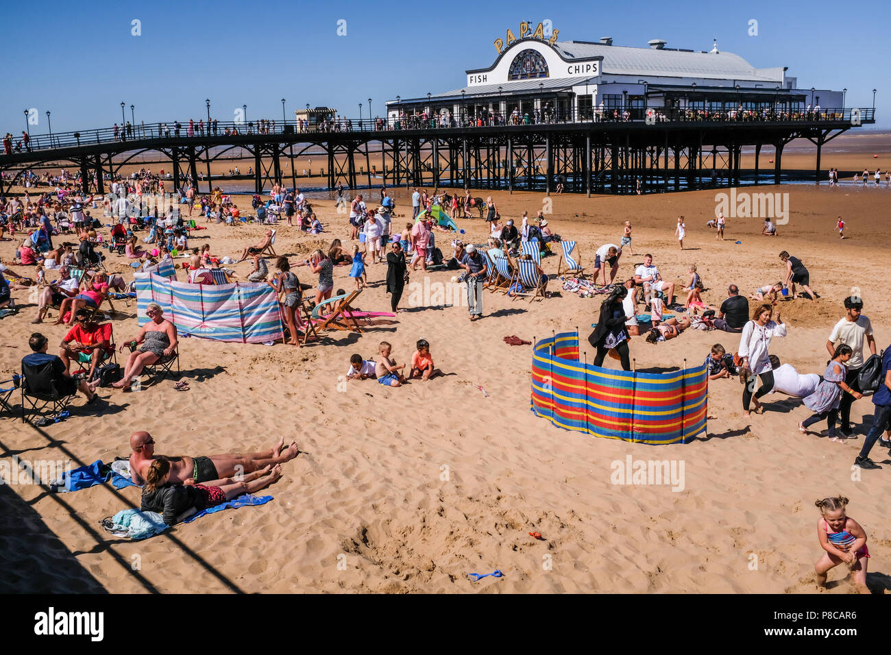 Cleethorpes seafront with tourists close to the pier during Armed forces event weekend. Cleethorpes England UK - Stock Image