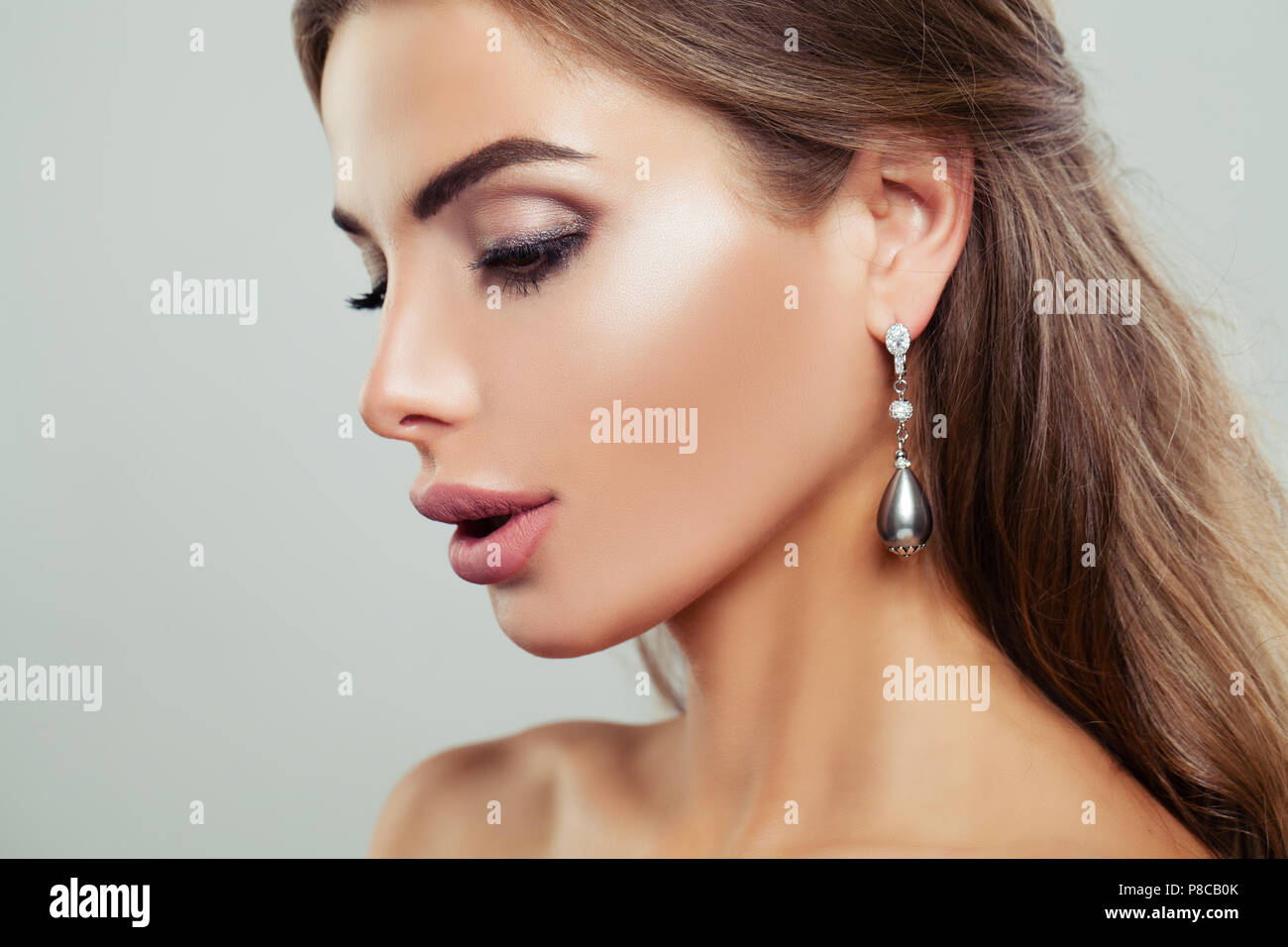 6f55efdbd Attractive Woman wearing Silver Earrings with Pearls and Diamond, Female  Face Closeup - Stock Image