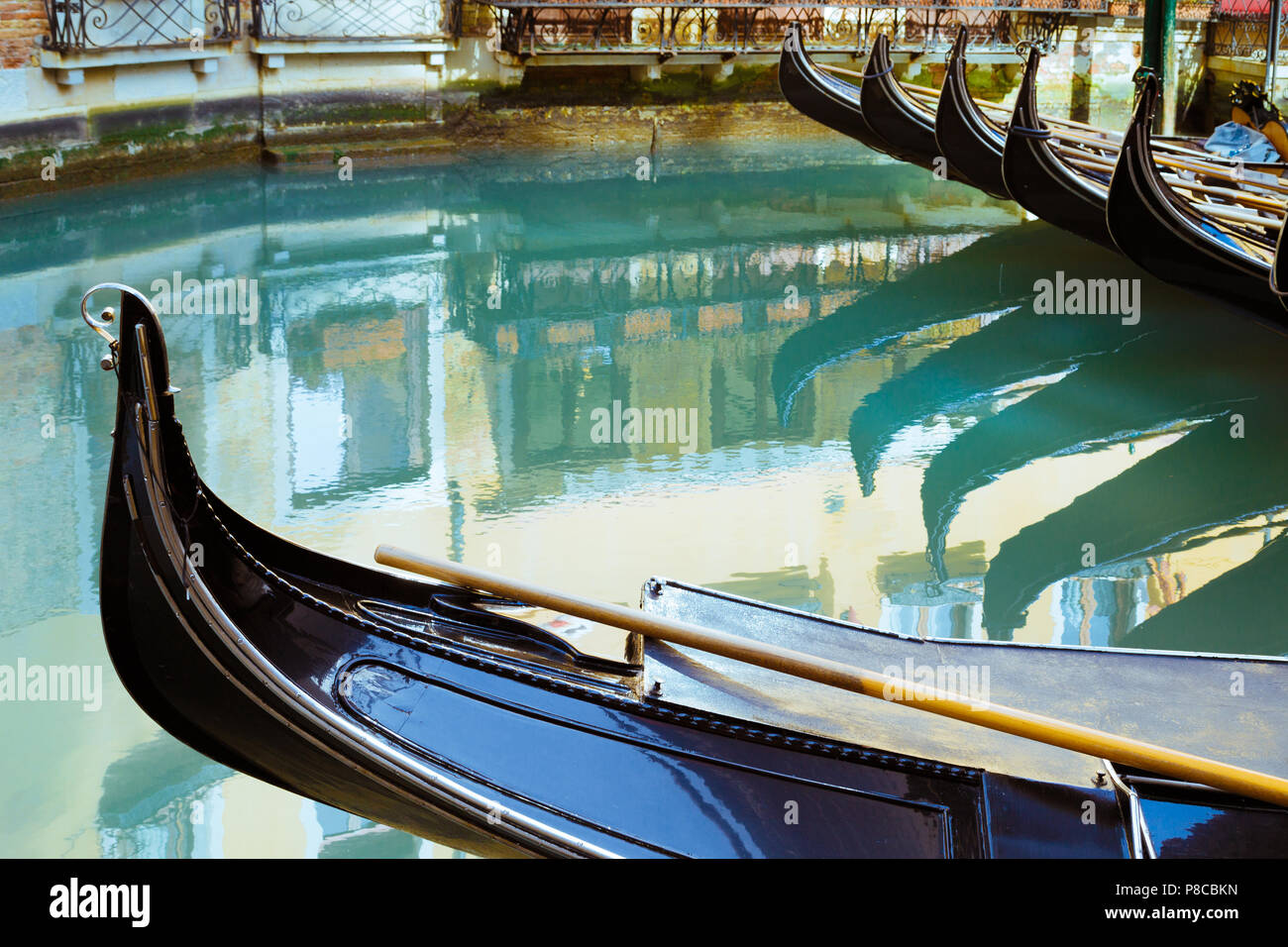 Gondols in still water with colorful reflection, Venice Italy - Stock Image