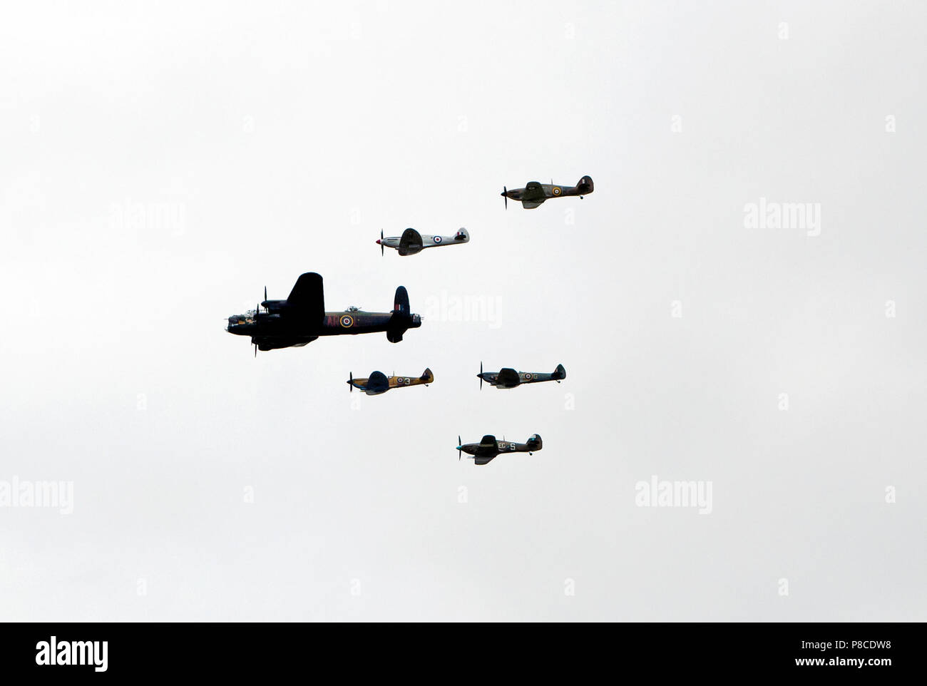 Lancaster, Hurricane and Spitfire Aircraft fly in formation over the Queen Elizabeth  Olympic Park  as part of the RAF Centennial Celebrations - Stock Image