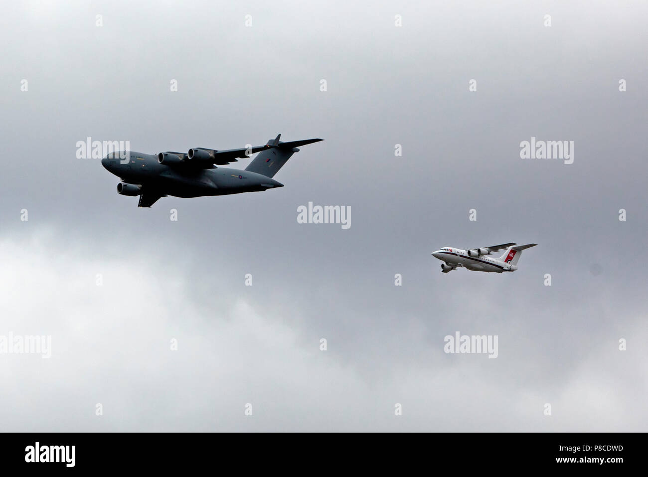 A C17  Globemaster and a BAe 146 fly in formation over the QE2 Olympic Park, as par of the RAF Centennial Celebrations - Stock Image