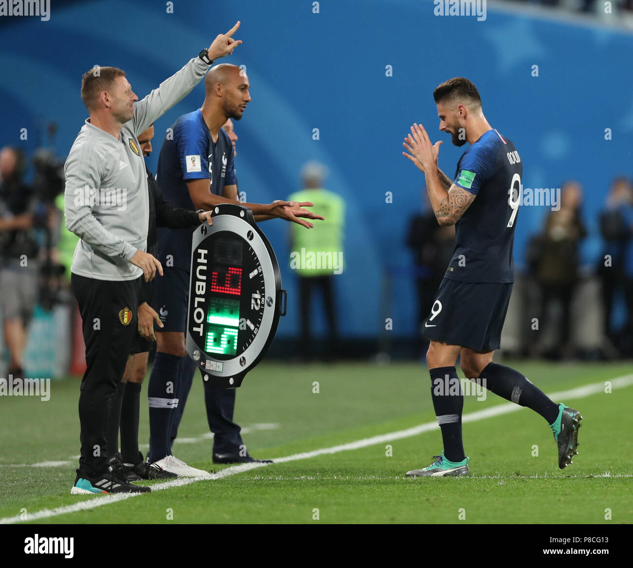 Saint Petersburg, Russia. 10th July, 2018. France's Steven Nzonzi (C) substitutes Olivier Giroud (R) during the 2018 FIFA World Cup semi-final match between France and Belgium in Saint Petersburg, Russia, July 10, 2018. Credit: Fei Maohua/Xinhua/Alamy Live News - Stock Image