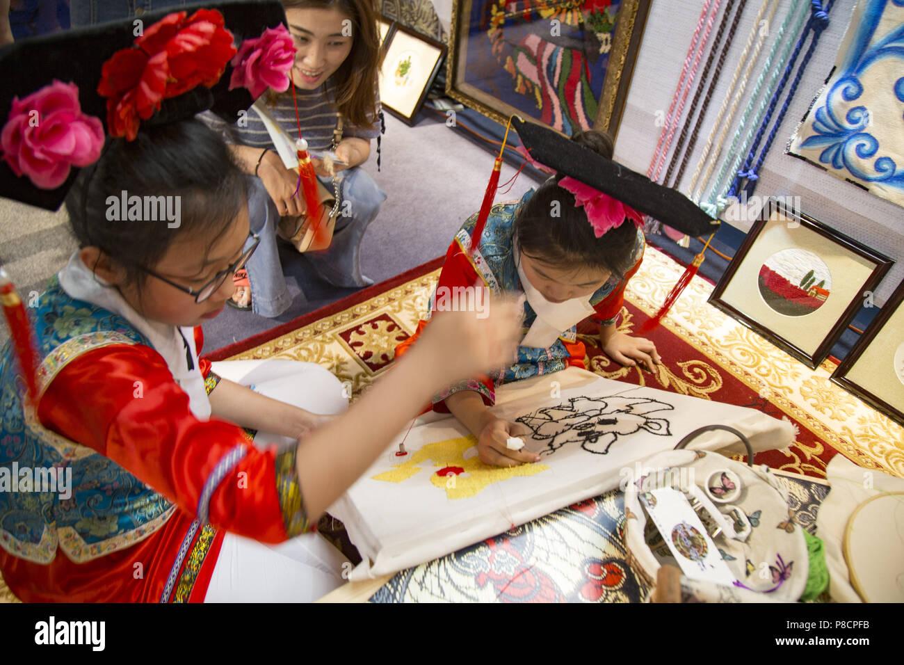 Jili, China. July 11, 2018. Pupils learn to make embroidery in northeast China's Jilin Province. Credit: SIPA Asia/ZUMA Wire/Alamy Live News - Stock Image