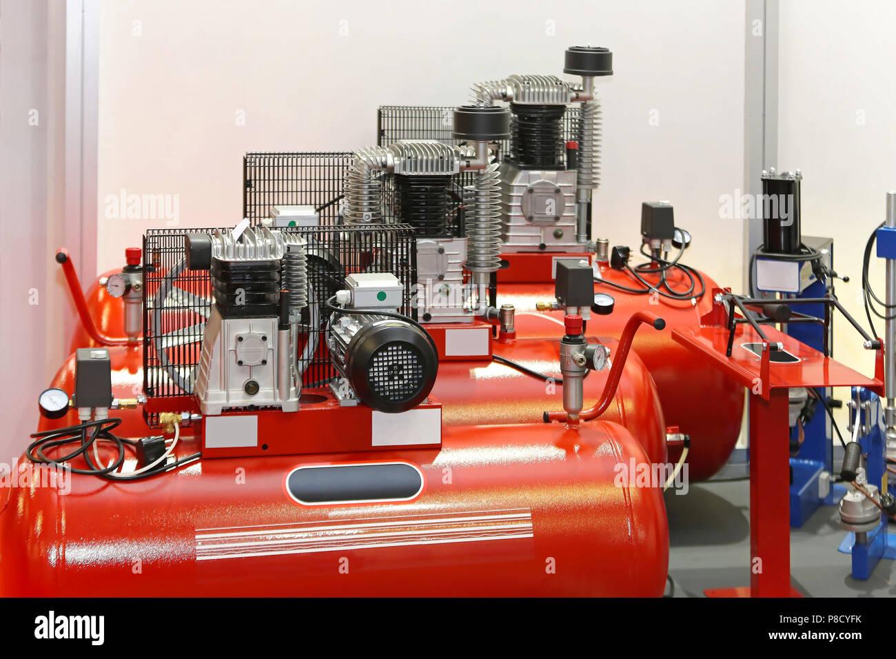 Air compressors in auto service garage Stock Photo