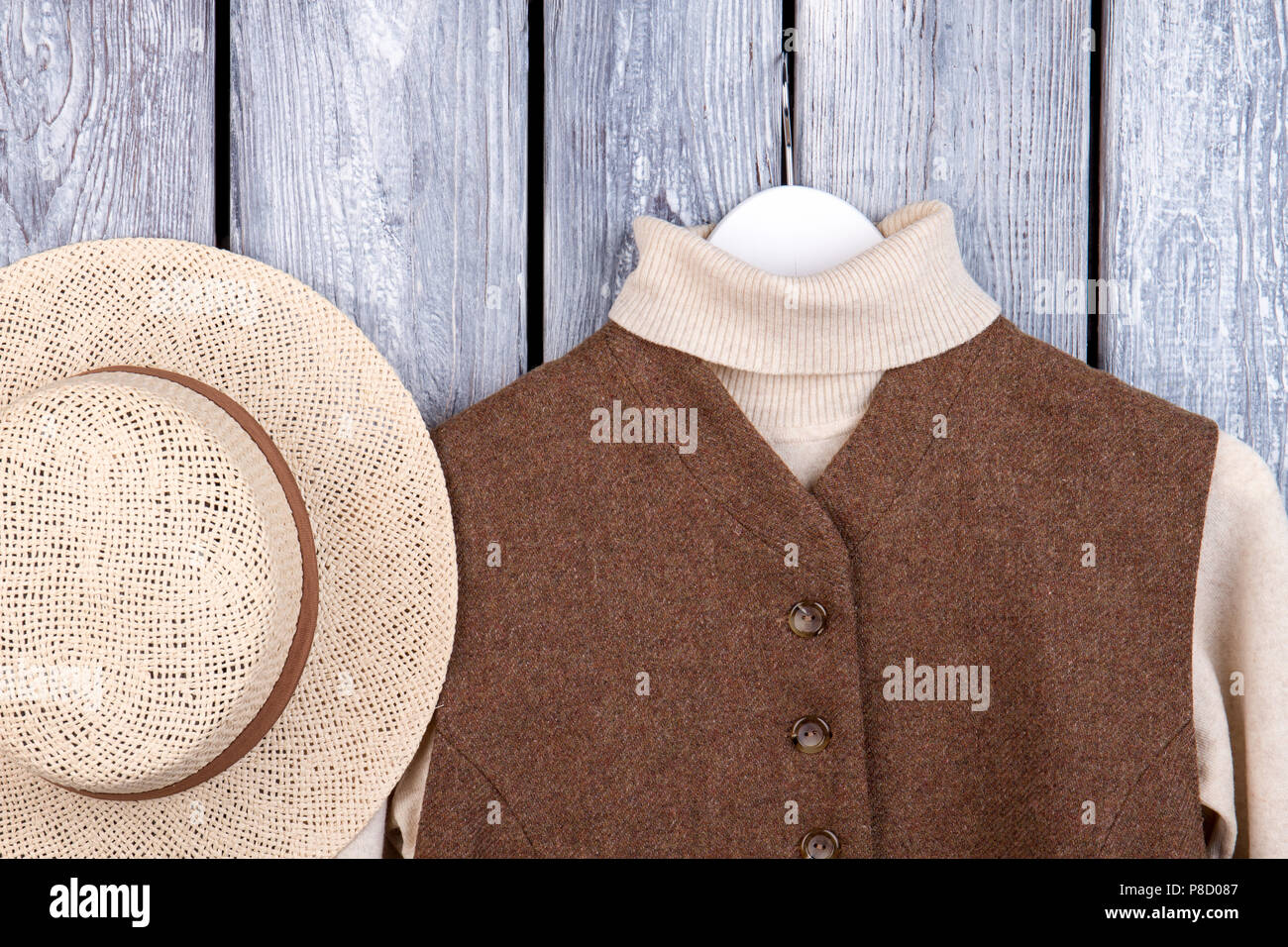 Top view straw and winter clothing. - Stock Image