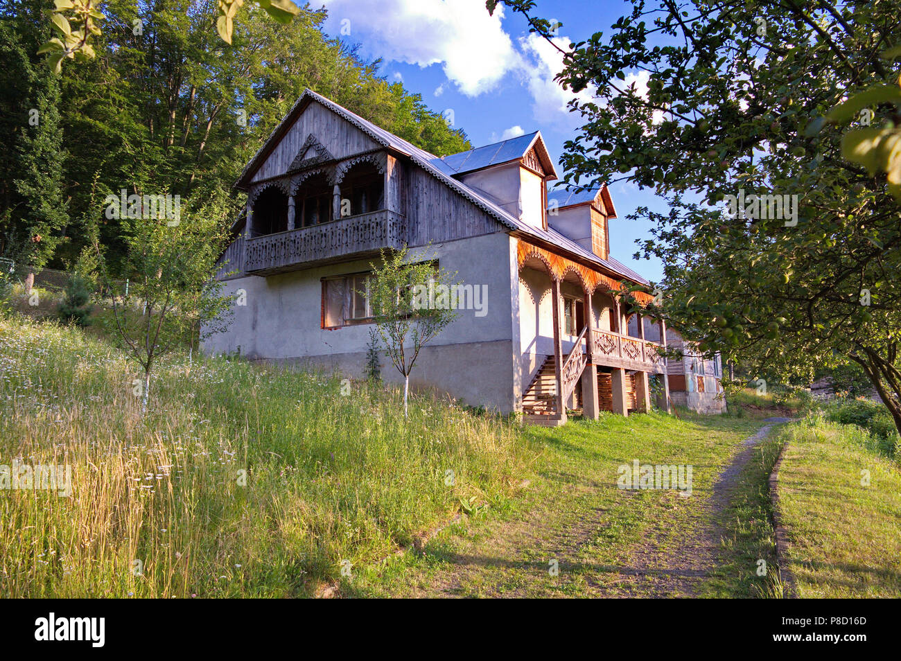 Two Storey House With Carved Balcony And Porch In The Village For Your Design Stock Photo Alamy