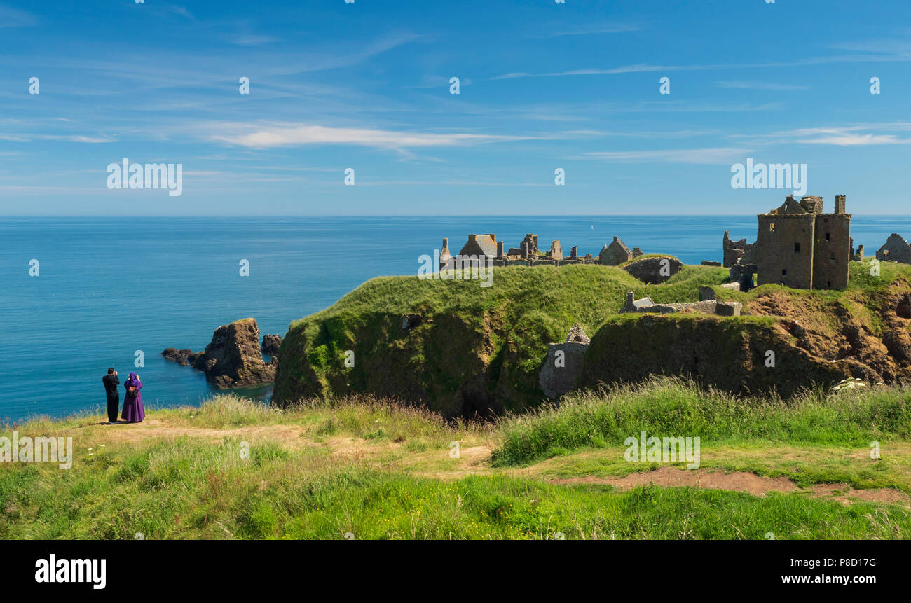 Dunottar Castle, Stonehaven, Aberdeenshire - one of Scotland's most identifiable strongholds, built in the 15th and 1y6th centuries. Photographing the Stock Photo