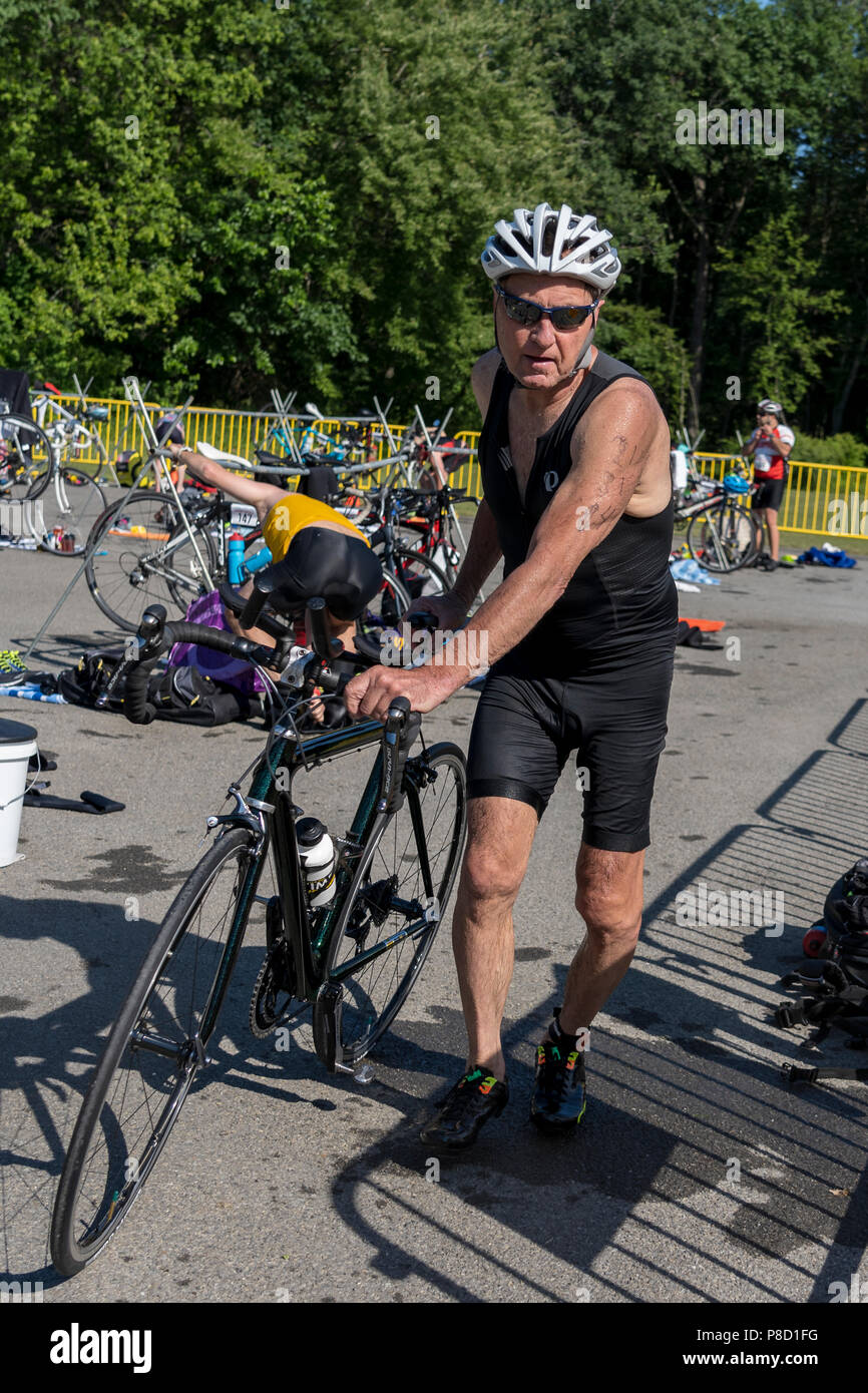 Jim Adams competiting in the bike segment in the 2018 Stissing Triathlon - Stock Image