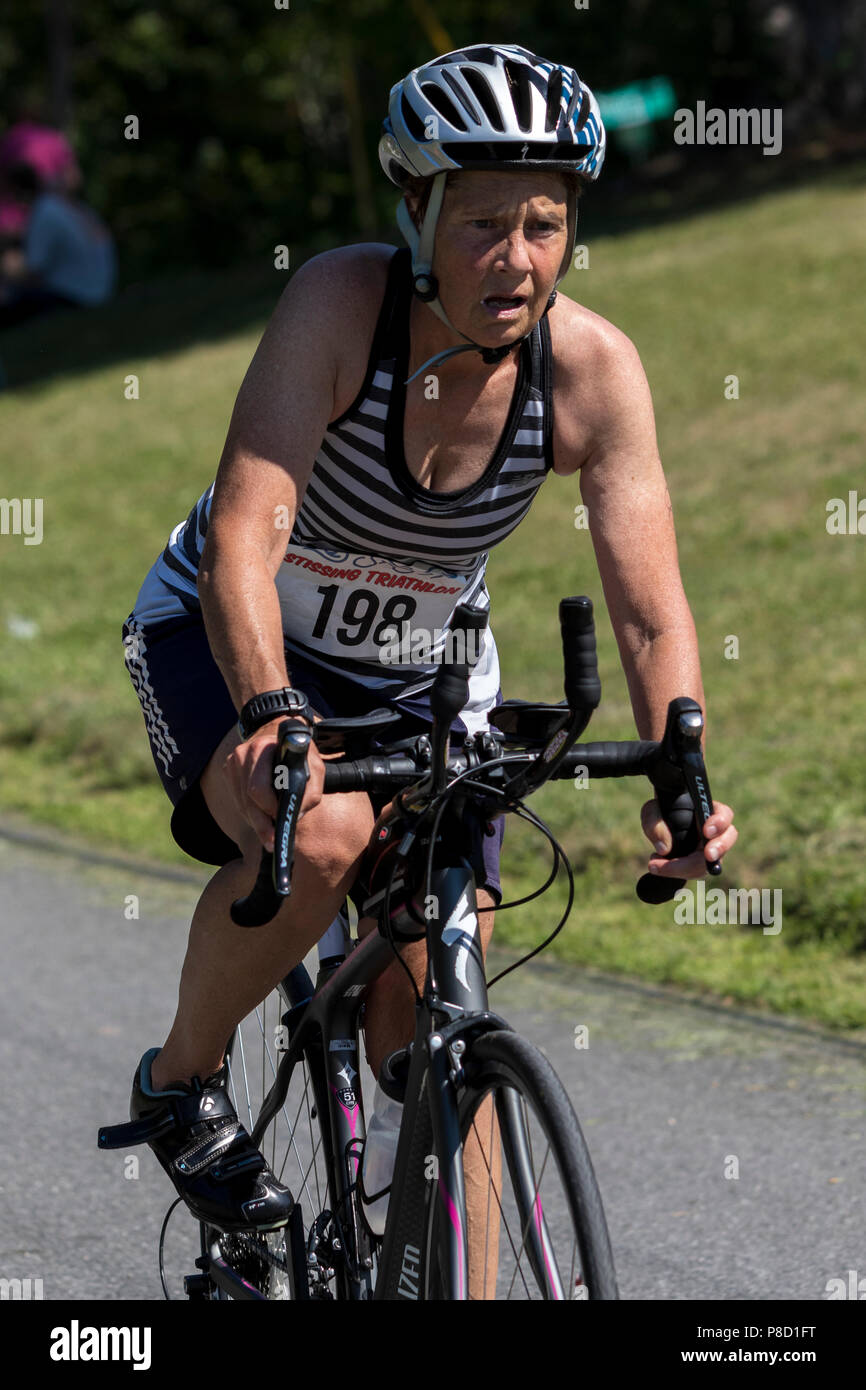 Mary Sheehan competiting in the bike segment in the 2018 Stissing Triathlon - Stock Image