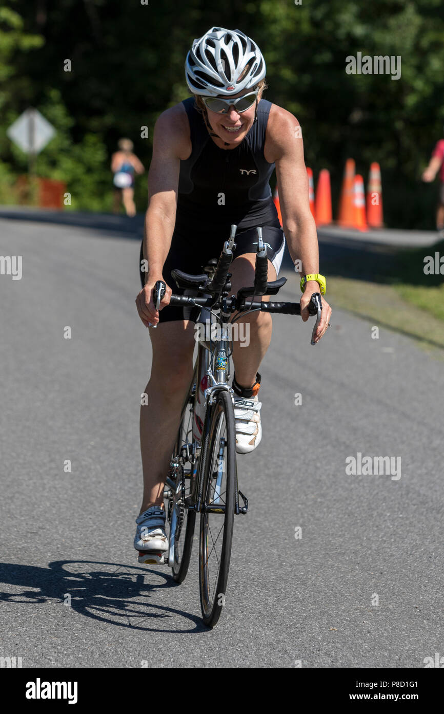 Female competitor in the run segment in the 2018 Stissing Triathlon - Stock Image