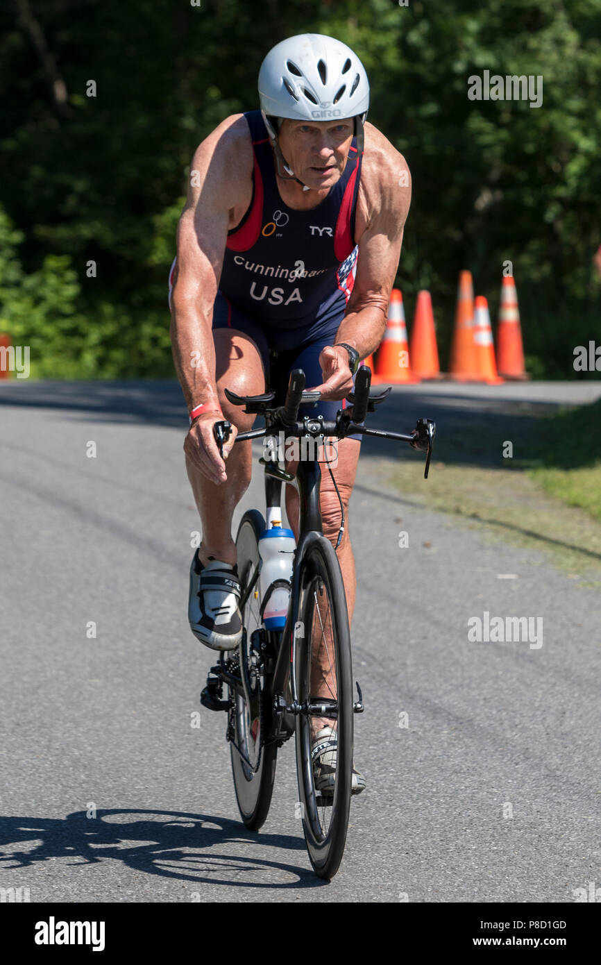Jim Cunningham competiting in the bike segment in the 2018 Stissing Triathlon - Stock Image