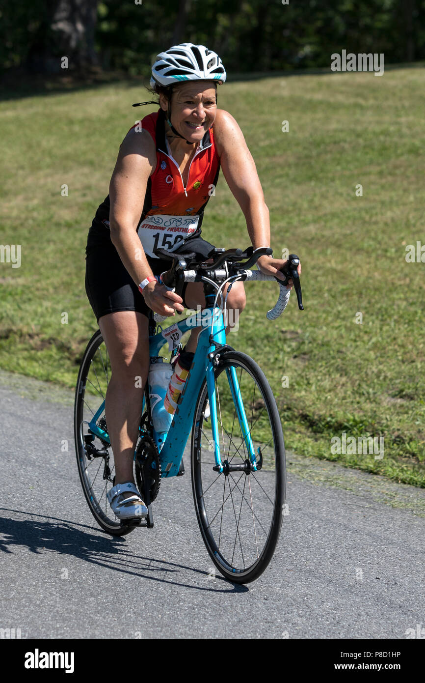 Jennifer Warren competiting in the bike segment in the 2018 Stissing Triathlon - Stock Image