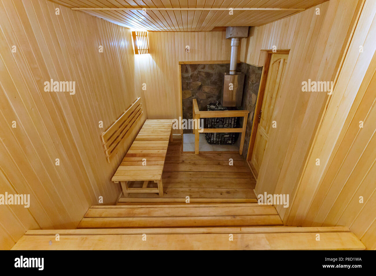 Beautiful and useful sauna with comfortable seats for sitting and lamps on the walls . For your design - Stock Image