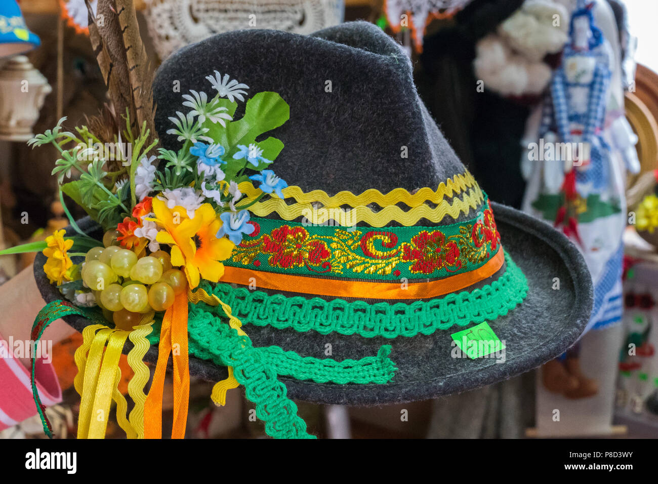festive national hat with ribbons and feather in the Carpathians . For your design - Stock Image