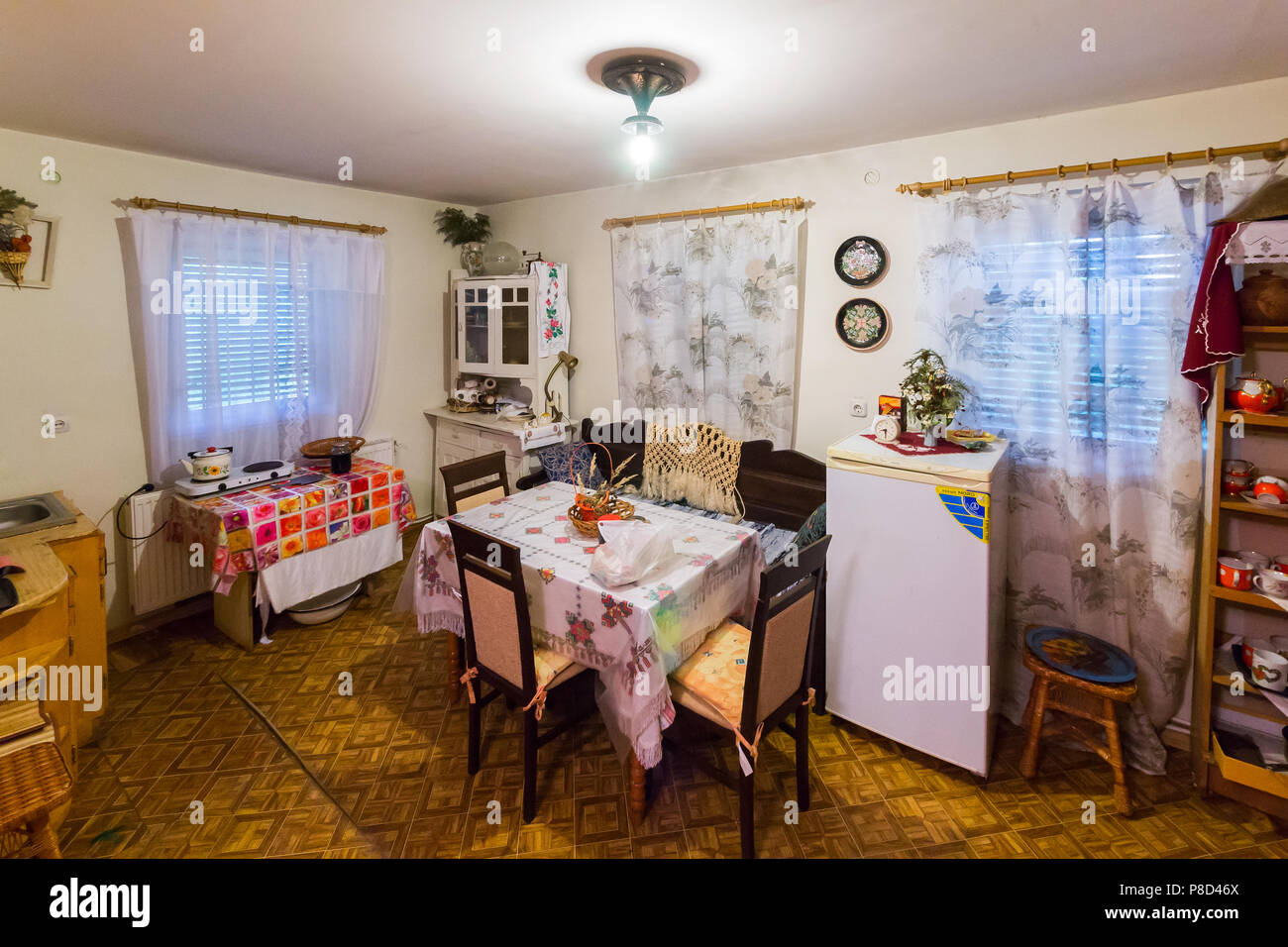 kitchen in a communal apartment with a small table in the ...