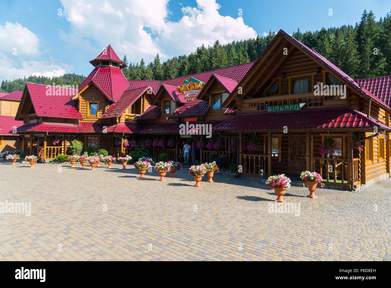 Beautiful authentic wooden recreation complex Olga against the background of green spruces. A place for relaxation with the whole family . For your de - Stock Image