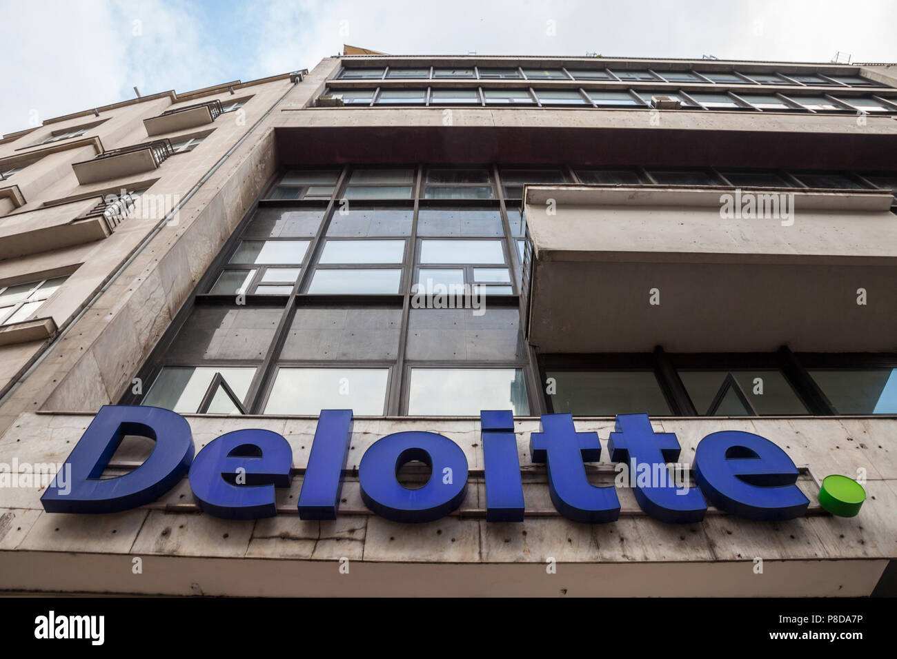 BELGRADE, SERBIA - JULY 8, 2018: Logo of Deloitte on their main office building in Belgrade. Deloitte is one of the main audit firms in the world, wit - Stock Image