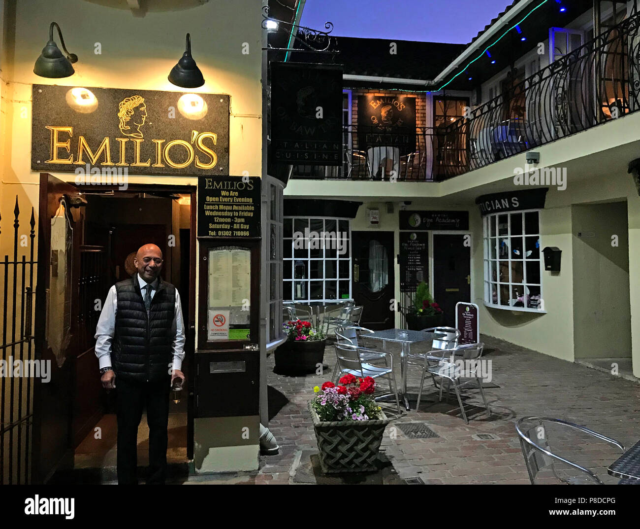 Emilio outside Emelios at dusk, 5-6 Dower House Square, Bawtry, Doncaster, South Yorkshire, England, UK, DN10 6LS - Stock Image