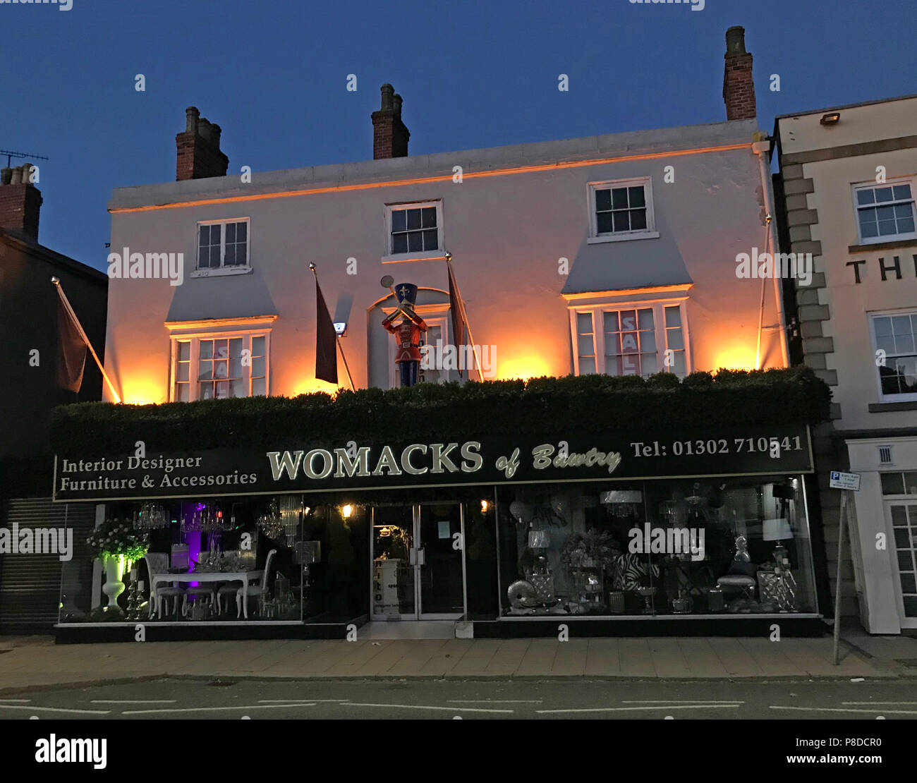 Womacks of Bawtry at dusk, 16-18 High St, Bawtry, Doncaster, South Yorkshire, England, UK,  DN10 6JE - Stock Image