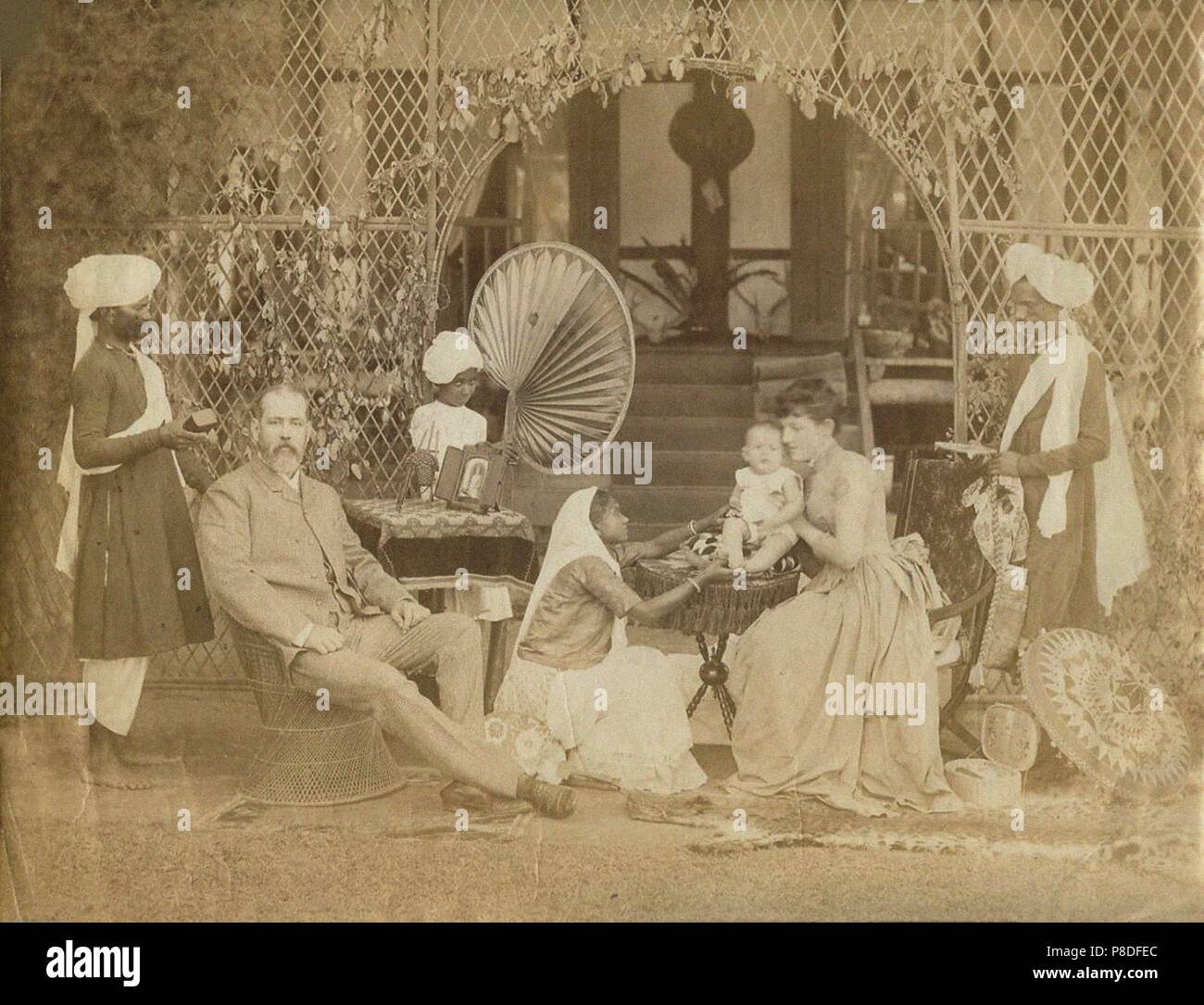 British family with Indian Servants in northeastern India. Museum: PRIVATE COLLECTION. - Stock Image