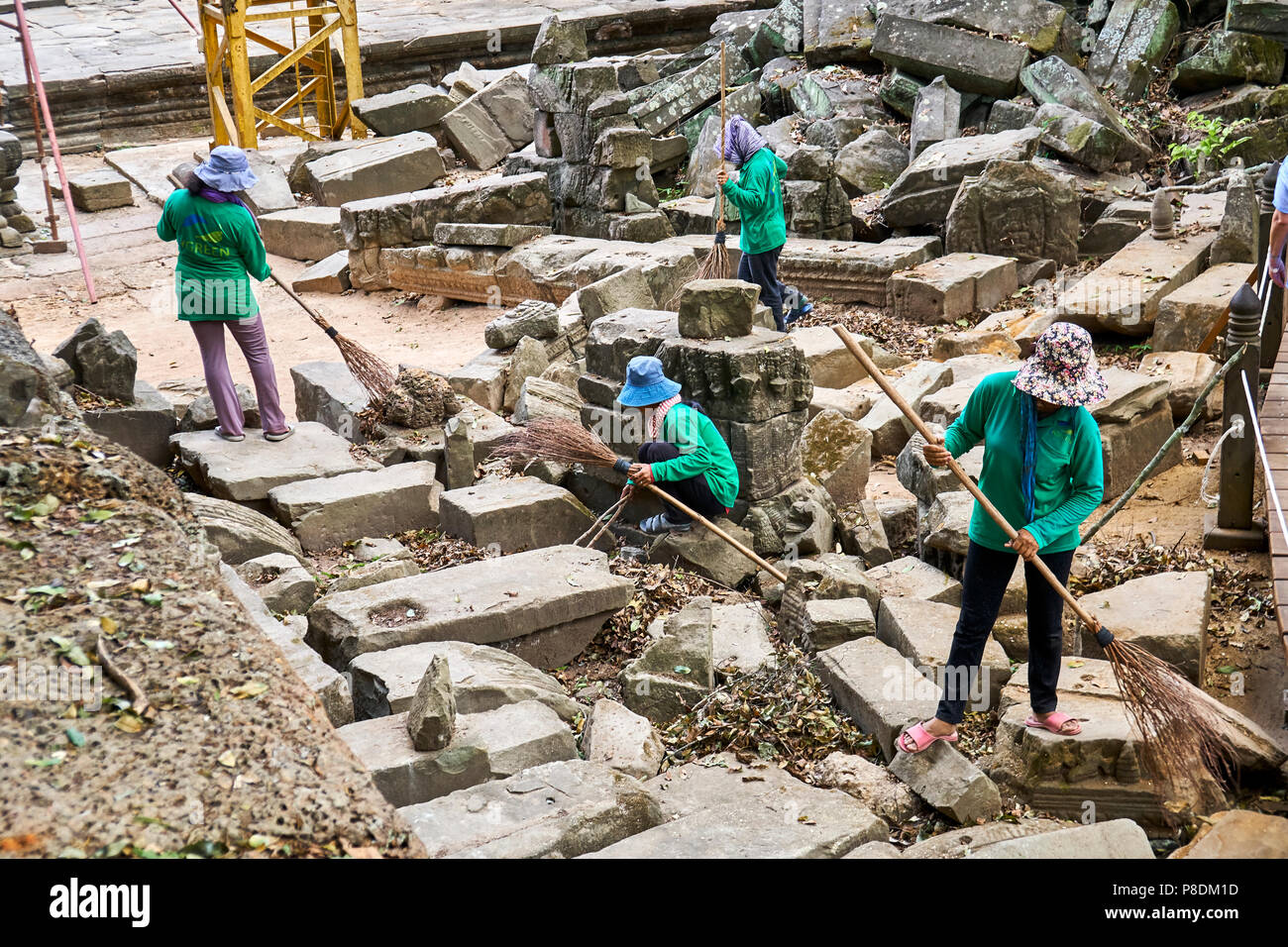 Cleaners sweeping at Angkor Thom - Stock Image