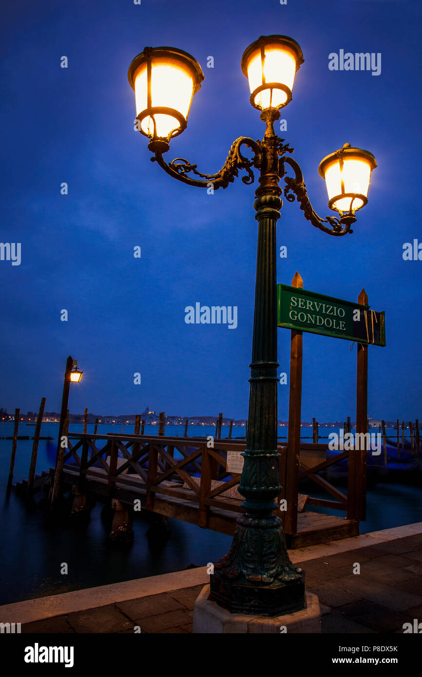 Dock along St. Mark's Square in Venice, Italy in the early morning hours - Stock Image