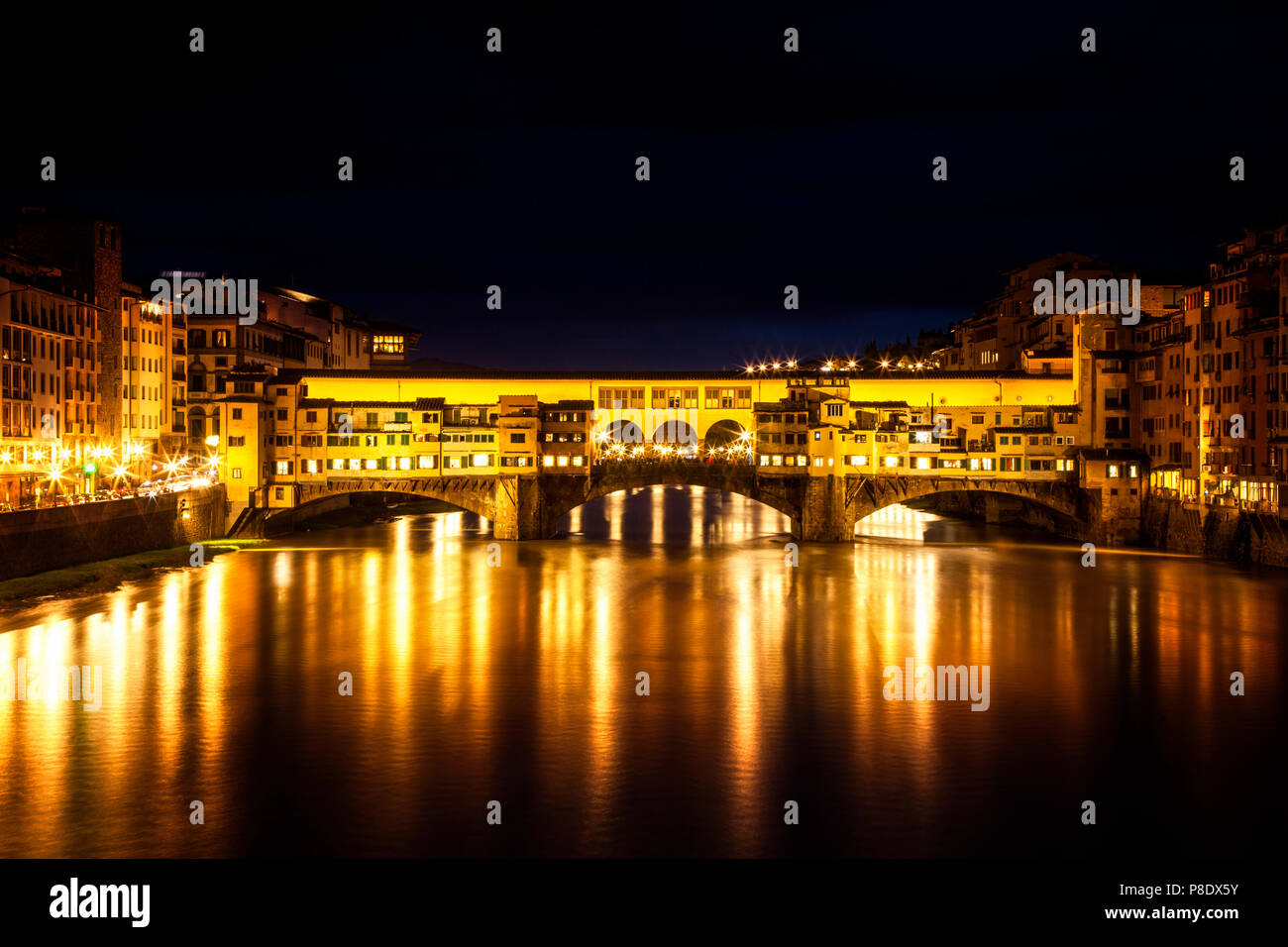 Florence, Italy's iconic Ponte Vecchio at night - Stock Image