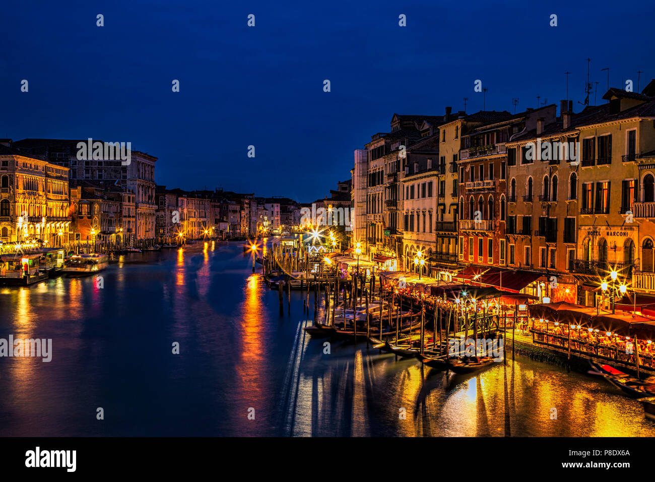View down the Grand Canal at twilight seen from the Rialto Bridge in Venice, Italy - Stock Image