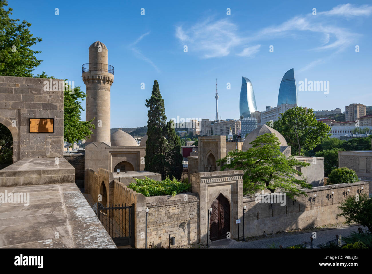 The Palace of the Shirvanshahs and The Flame Towers in the background , Baku, Azerbaijan - Stock Image