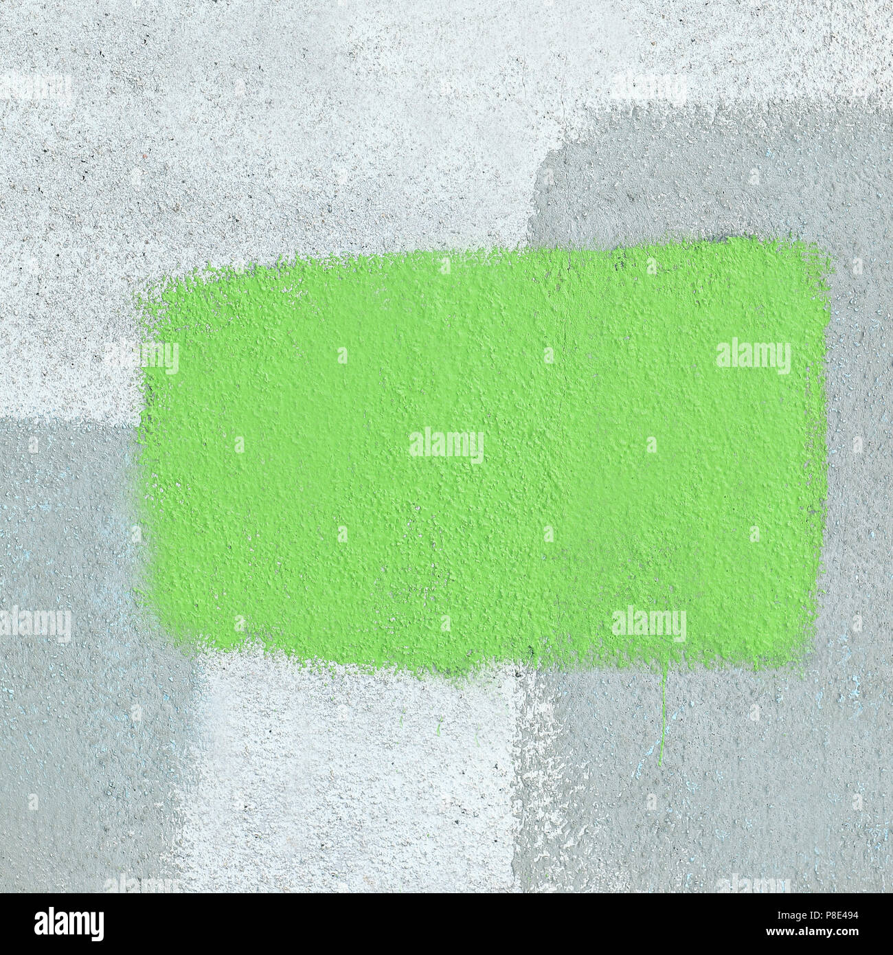 green frame painted with paint on the cement wall abstract