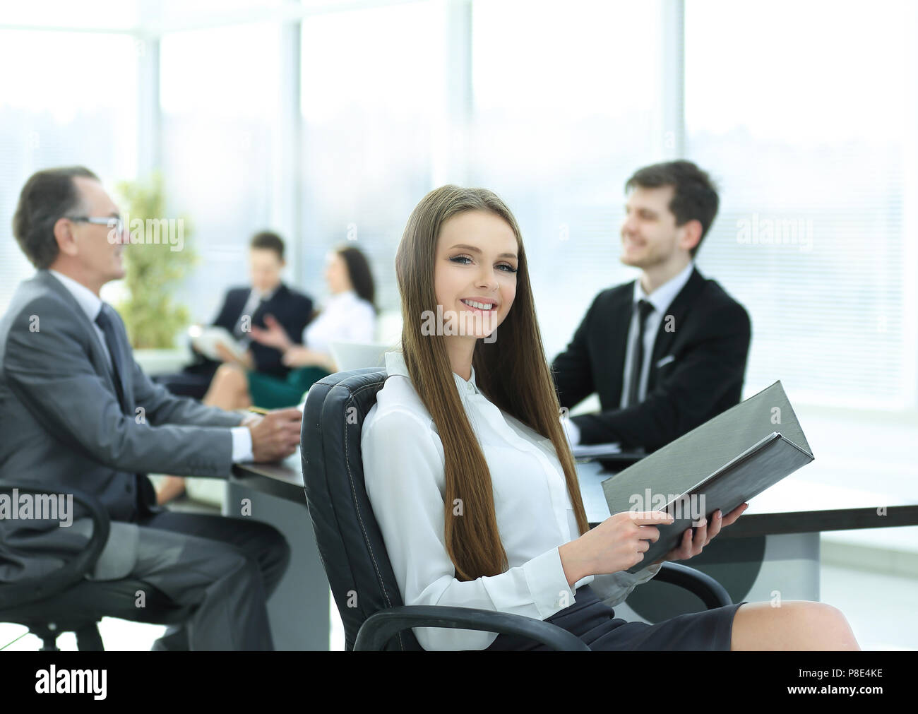Executive business woman with clipboard modern office - Stock Image
