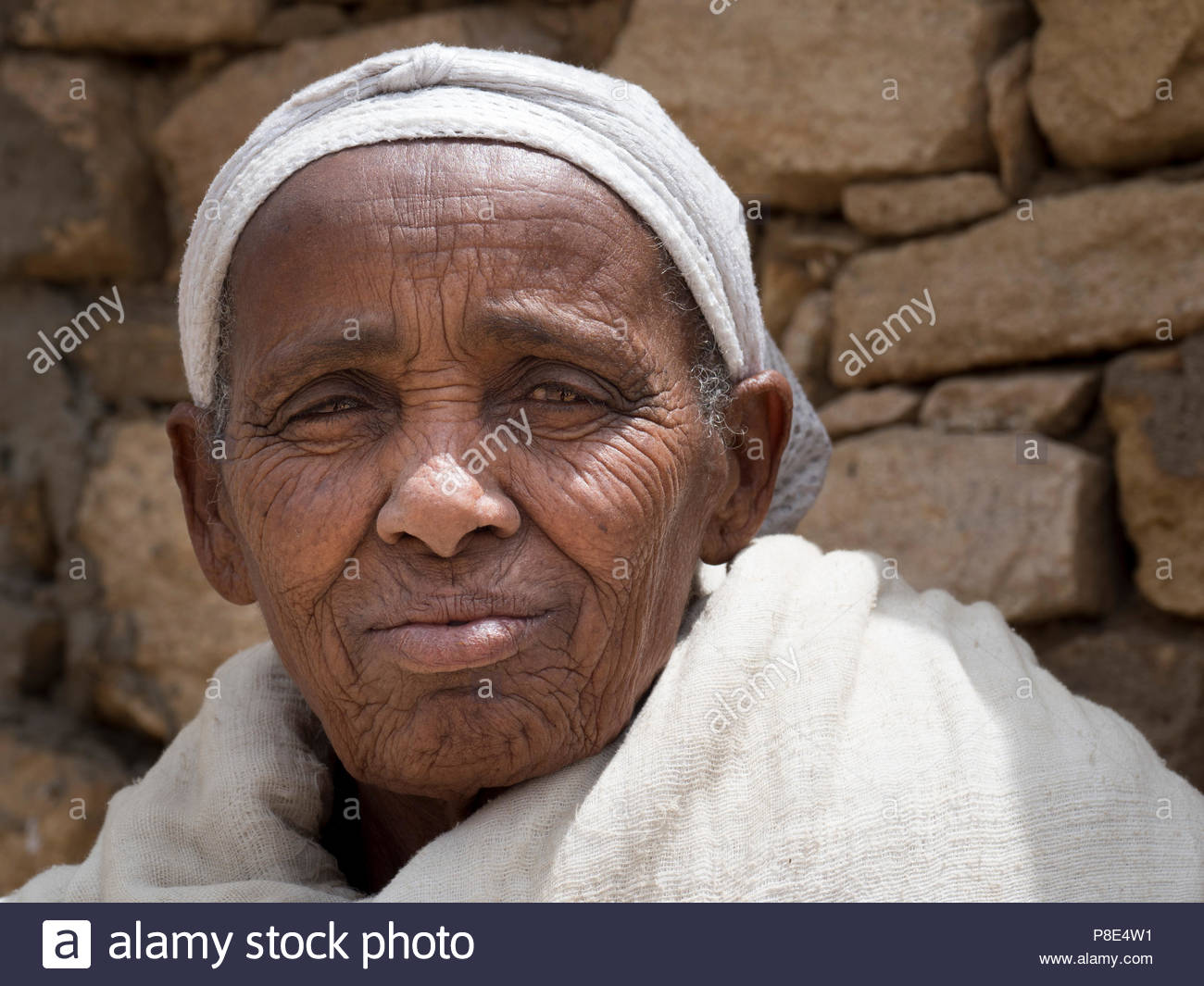 Old woman with wrinkles, white clothes, portrait, Ethiopia - Stock Image