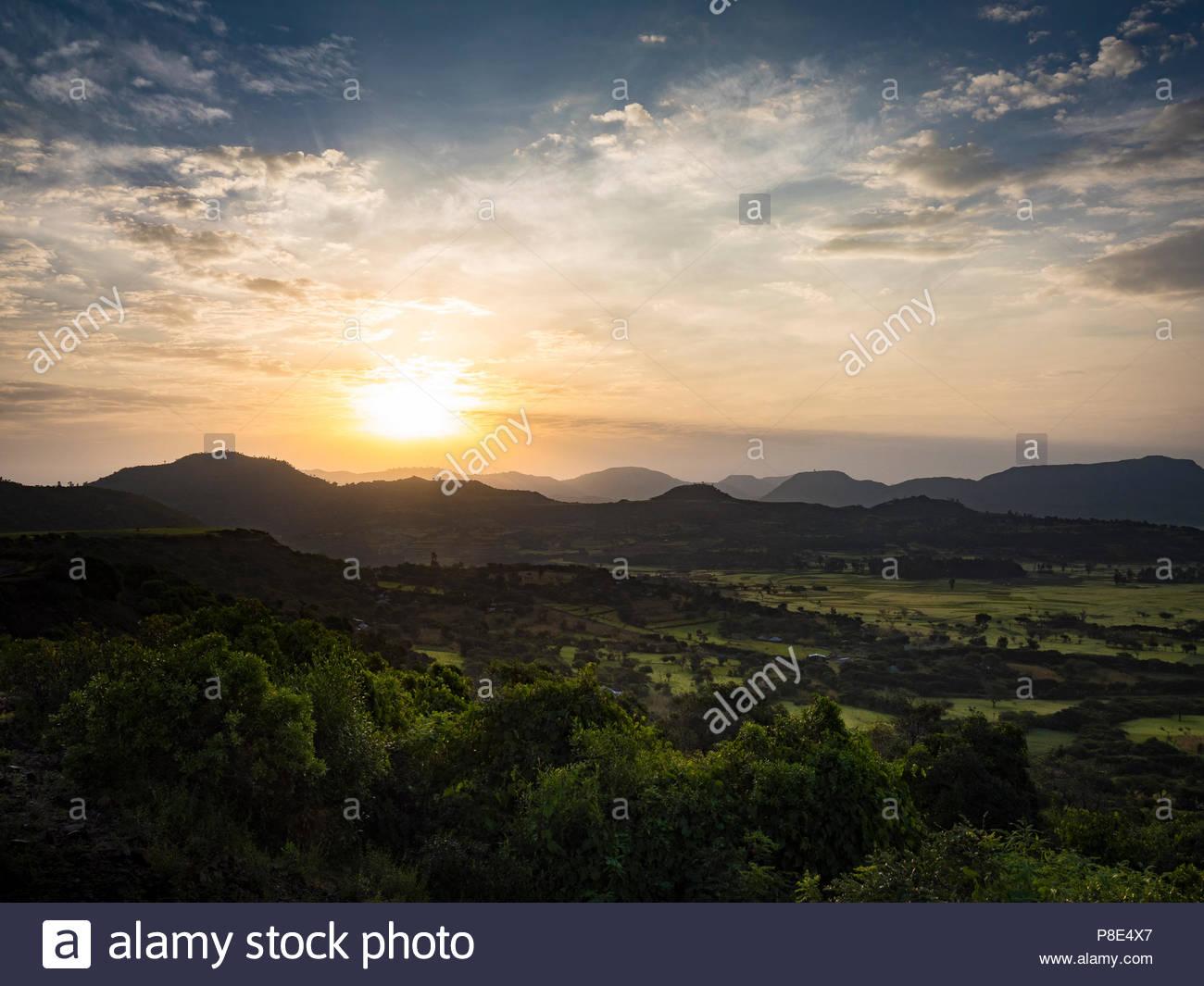 Mountainous green landscape at sunrise, at Axum, Ethiopia - Stock Image