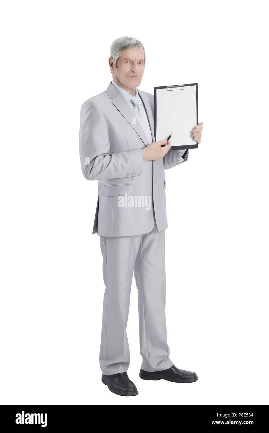 Mature businessman pointing at blank sheet.isolated on a white - Stock Image
