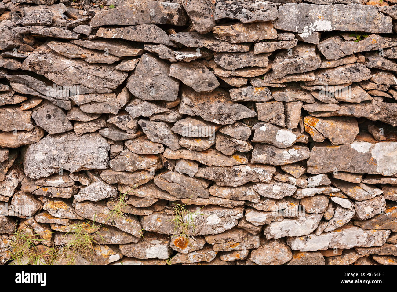 Old stone wall background texture. - Stock Image