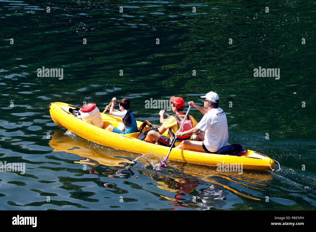 Canoeing downhill on the the Herault river, Laroque, Occitanie France - Stock Image