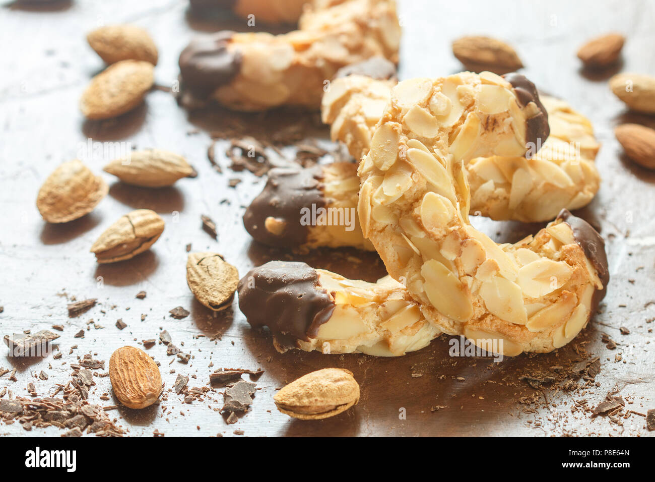 Homemade shortbread cookies with almonds and chocolate. Crispy dessert for tea and coffee. Selective focus - Stock Image