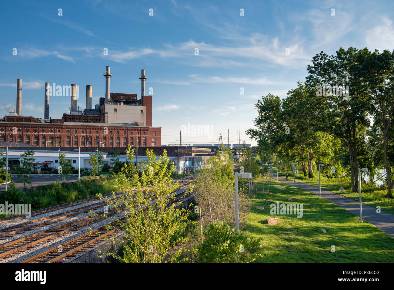 Schuylkill Banks Recreation Path in revitalized industrial area with Veolia Thermal Energy Plant, Philadelphia , Pennsylvania, USA - Stock Image