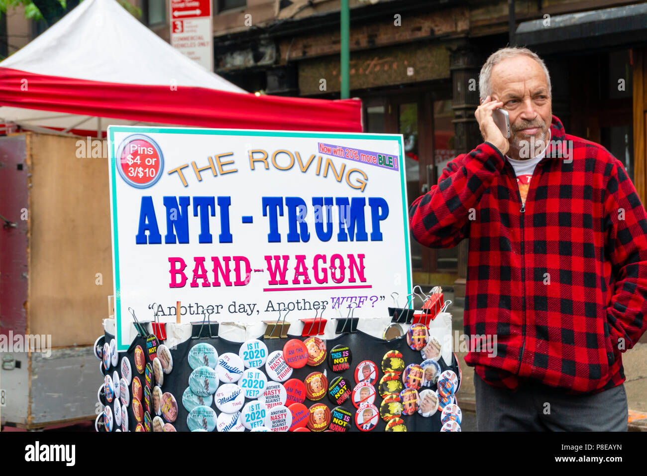 Anti-trump pins for sale at a stall in New York City - Stock Image