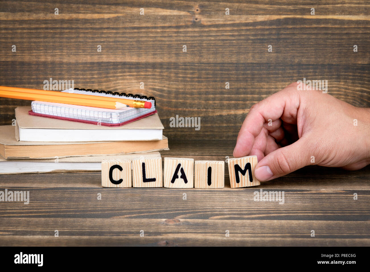 Claim. Wooden letters on the office desk - Stock Image
