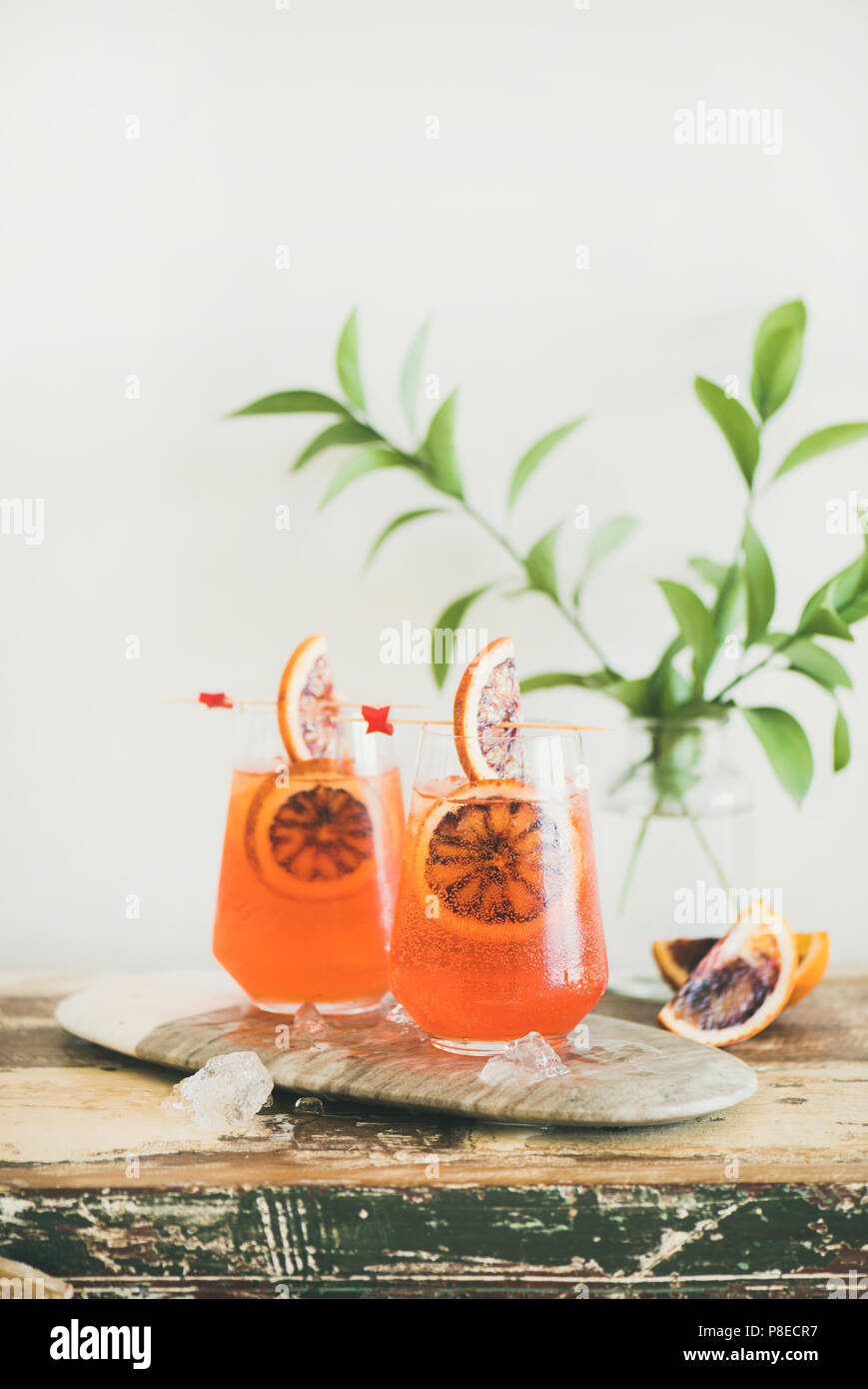 Glasses of Aperol Spritz alcohol cocktail with orange and ice - Stock Image