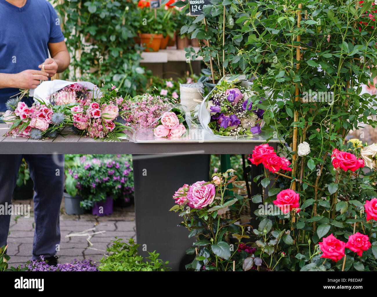 Male Florist Creating Beautiful Bouquet In Flower Shop Outdoor