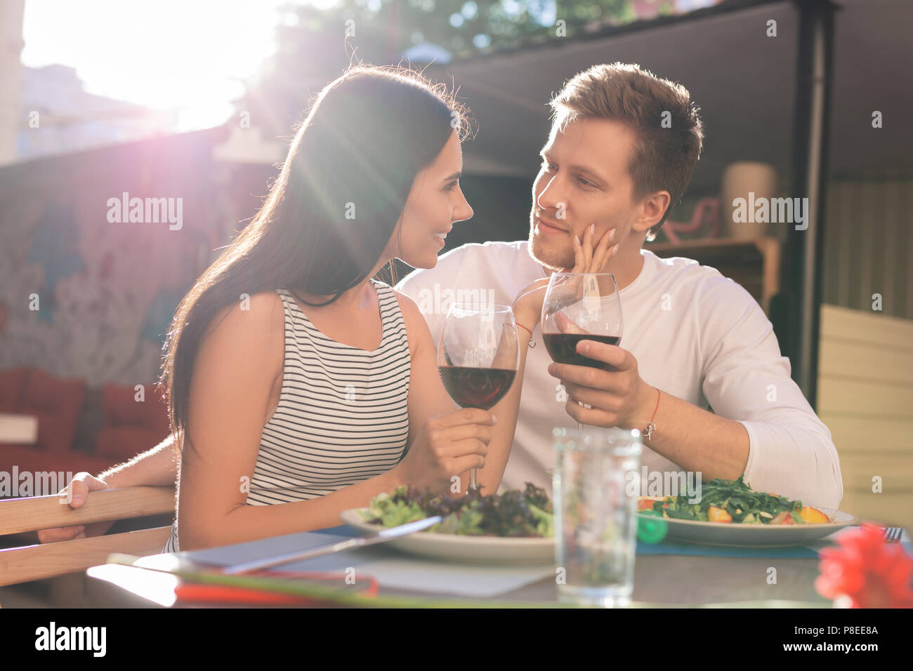 Young couple celebrating their relationship anniversary - Stock Image