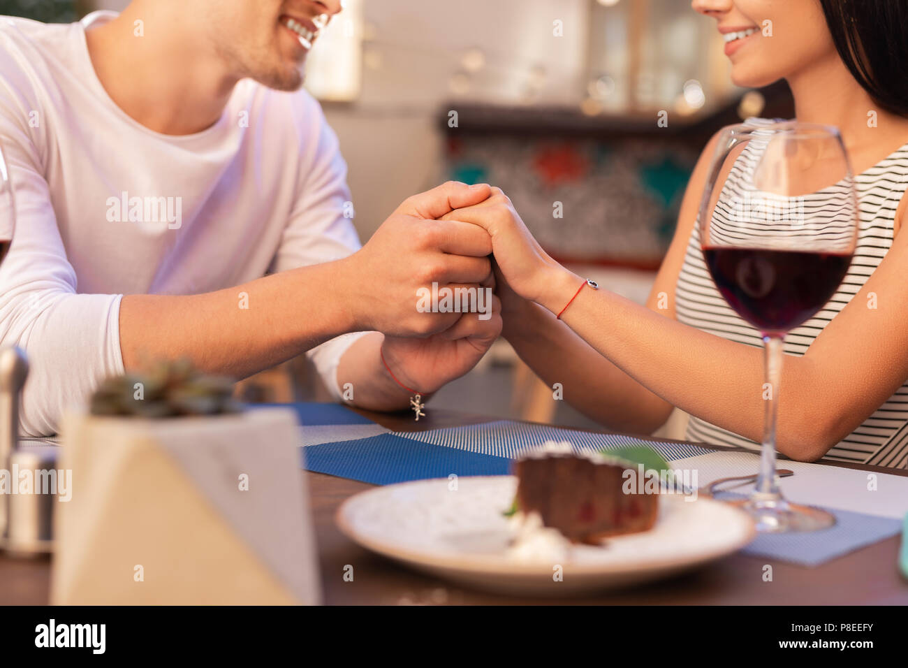 Smiling man telling his beautiful woman about his love - Stock Image
